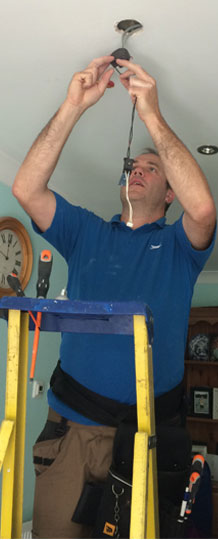 Gary Palumbo - electrician repairing lights